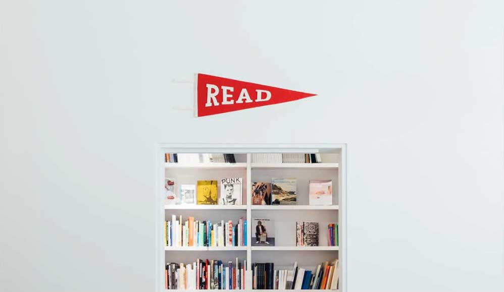 A bookshelf with read written over it